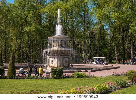 Petergof, Russia - June 5, 2017: Roman fountain. This is one of two symmetrical fountains. By composition, they resemble stone water cannons in the square in front of St. Peter's in Rome.