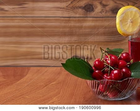 Ripe red cherry for making a cold drink, invigorating in the summer.