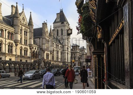 LONDON, GREAT BRITAIN - SEPTEMBER 19, 2014: The Royal Court of London is a monumental complex of neo-Gothic buildings on Strand Street in the city center.