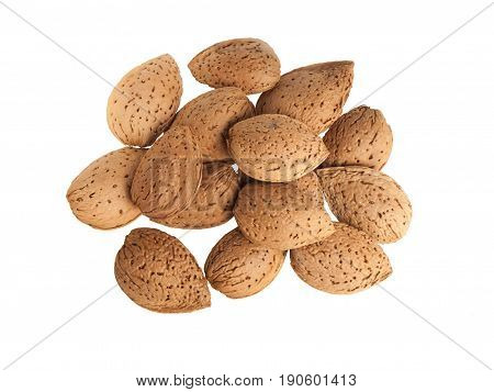 Heap of almonds seeds isolated on white background