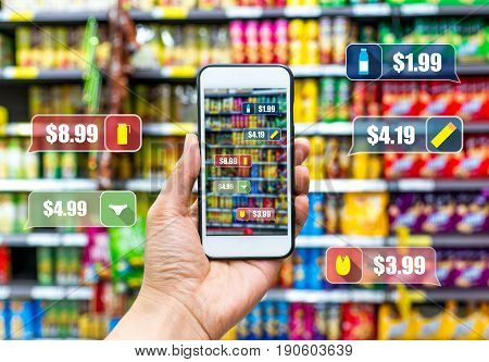 man holding the smart phone using the Augmented Reality buy some food in the supermarket