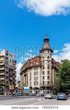 BUCHAREST, ROMANIA - MAY 14, 2017: Scenes from the downtown of Bucharest, capital and largest city of Romania and its cultural, industrial and financial centre located on the Dambovita River.