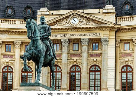 BUCHAREST, ROMANIA - MAY 14, 2017: Monument to the King Carol I in front of the Central University Library founded in 1895. The building was completed in 1893 and opened in 1895.