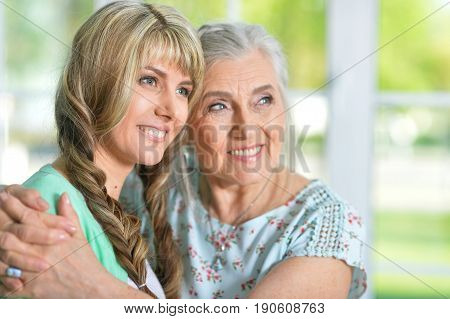 Family portrait of beautiful young woman with her mother
