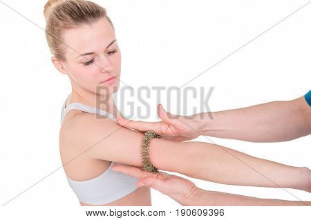 Woman getting hand acupuncture massage with Acupressure Finger Massage Ring