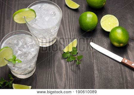 Fresh Cocktail With Lime, Ice And Mint On A Rustic Background. Copy Space, Top View