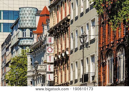GLIWICE, POLAND - MAY 1, 2017: Main street view with the tenement being an interesting example of modernism style. Characteristic rounded corner is filled with milk glass which is illuminated at night.