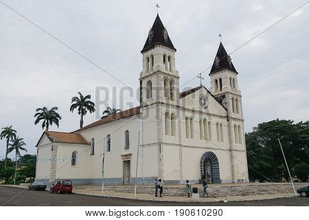 SAO TOME, SAO TOME AND PRINCIPE - FEBRUARY 1, 2017: People in front of the cathedral of Sao Tome city in the evening hours on February 1, 2017 in Sao Tome and Principe, Africa