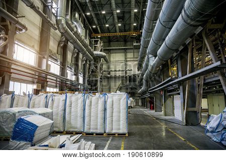 Packing area at chemical factory. Bags with chemical production