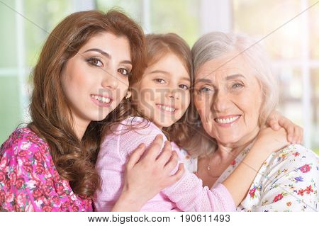 Happy family portrait of three female generations