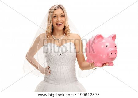 Bride with a piggybank looking at the camera and smiling isolated on white background