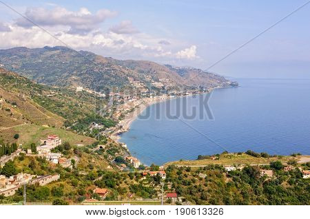 View of the coast of the Ionian Sea and the bay of Giardini Naxos from Teatro Greco - Taormina, Sicily, Italy