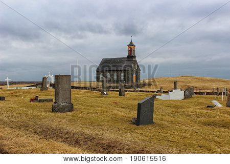 A black church in the middle of nowhere in Iceland