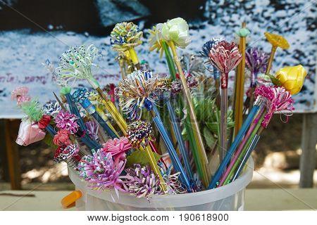 plastic flower stick charity merit wat buddha