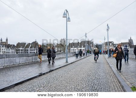 MAASTRICHT NETHERLANDS - FEBRUARY 20 2016: Bridge over the Meuse river in the historical center of Maastricht a city and a municipality in the southeast of the Netherlands