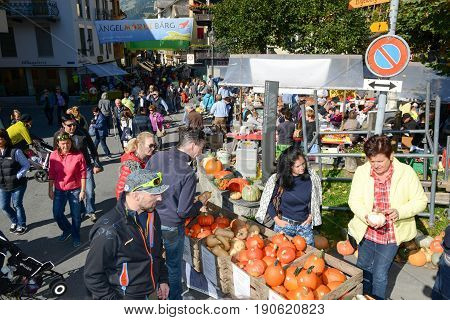 People Selling And Buying Pumpkins At The Market In Engelberg