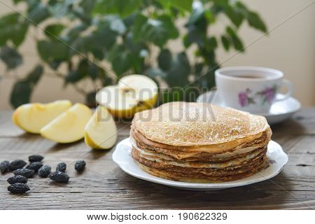 Hot pancakes on a plate, sweet home baking