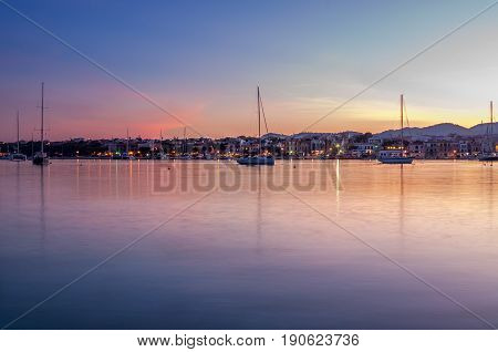 Sailboats in the magic hour. Sunset at the harbor