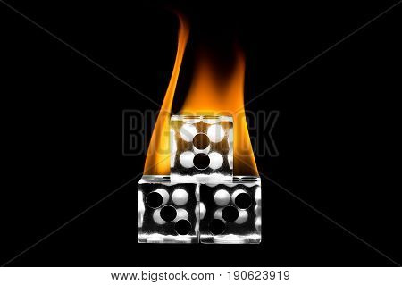 Dice stacked. Fire on the dice. Clear cube.