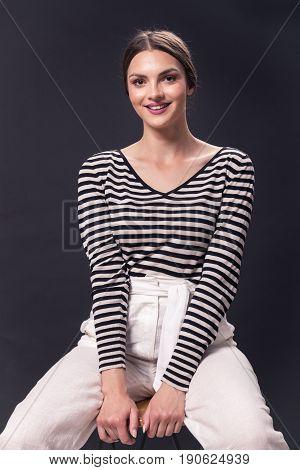 One Young Caucasian Smiling Woman 20S, 20-29 Years, Fashion Model Sitting Bar Stool, Posing, Studio,