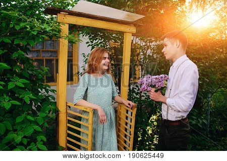 Guy Gives His Girlfriend A Bouquet Of Lilacs, She Came Out Of The Gate