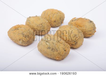 A Handful Of Homemade Croquettes Of Spinach Isolated On White