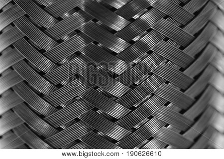 Vertical metal wire braiding. Steel texture. Background. Template.