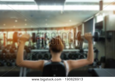 Burred Image Woman Weight Lifting Dumbbell Bodybuilding In Workout Fitness Gym