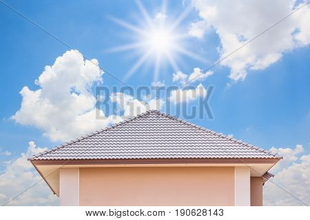 roof of the house on blue sky background.