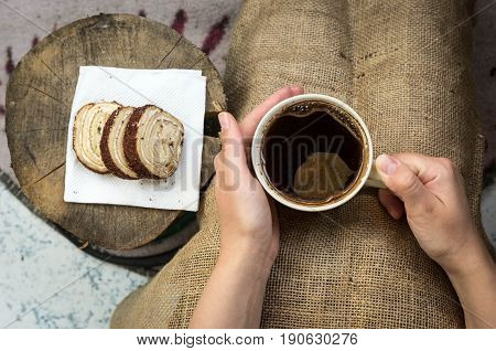 Palms Warming Cup Of Hot Coffee. Man Holding A Cup Of Coffee And Piece Of Cake.