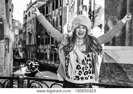 Smiling Traveller Woman In Venice, Italy In Winter Rejoicing