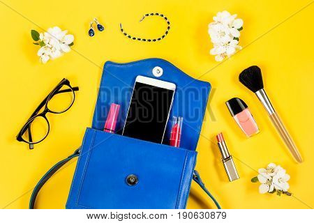 Things from a woman purse, female accessories on a bright colorful background