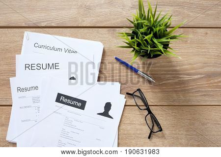 Resume Applications On The Desk Ready To Be Reviewed