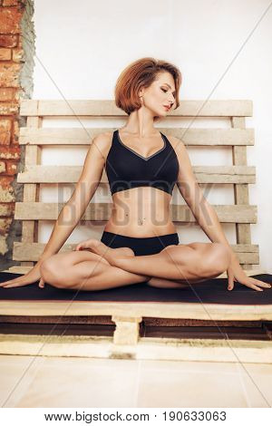 Portrait young woman doing yoga exercise   At home