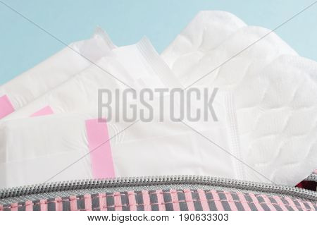 Menstrual Tampons And Pads In Cosmetic Bag. Menstruation Time. Hygiene And Protection