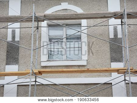Painting and Plastering Exterior House Scaffolding Facade Wall Exterior.