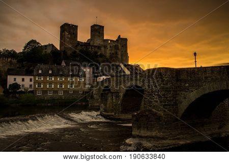 Runkel, Germany - April 23 2017: Burg Runkel during sunset with dramatic sky in Runkel, Hessen, Germany.