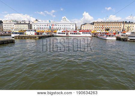 HELSINKI FINLAND - JUNE 10 2017: Sightseeing boats in Helsinki city center harbor in Finland on June 10 2017