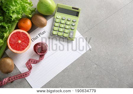 Diet plan and healthy foods on light background