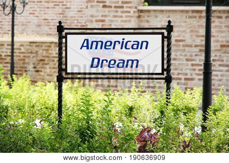 Sign board with text AMERICAN DREAM, outdoor