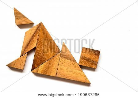 Wooden tangram puzzle in falling man shape on white background (Concept of business failure or crisis)