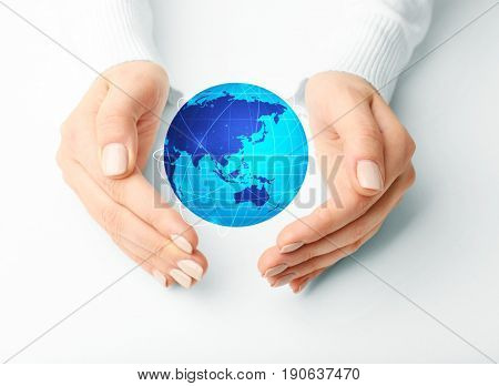 Woman protecting globe on white background. Concept of global leadership and geopolitics