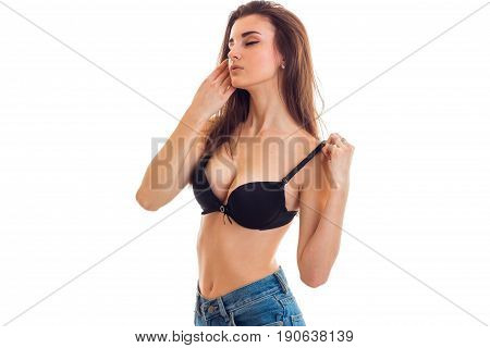 sexy woman with big breasts takes off bra isolated on white background