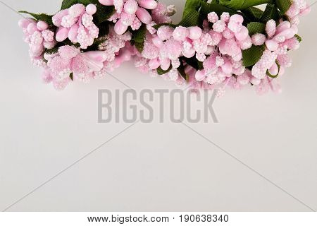 Half of pink artificial bouquet. Artificial element of festive decoration.