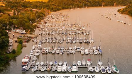 Pier of yachts and ships in Rochefort - en - Terre. River in Brittany. France