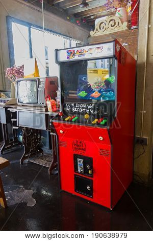 BANGKOK THAILAND - MAY 1 : red vintage arcade machine with two joysticks and push buttons in a room on May 1 2017 in Bangkok Thailand.