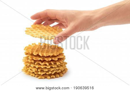 Female Hand Holds Homemade Crisp Waffle. Isolated On White Background