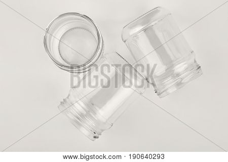 Closeup glassware containers, white background. Group of flass vessels.