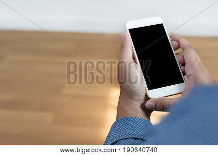 Cropped Shot Of Man's Hands Holding Smart Phone With Blank Copy Space  White Screen Vintage Tone Cop