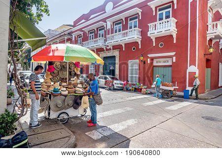 Cartagena, Colombia- March 2, 2017: Street vendors in Cartagena displaying sombreros Colombia
